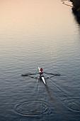 Rowing shell on Charles River, foggy, Boston, Massachusetts. USA