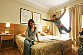 Accommodation, Action, Activity, Adult, Adults, Bed, Bedroom, Bedrooms, Beds, Blurred, Bond, Bonding, Bonds, Caucasian, Caucasians, Color, Colour, Contemporary, Couple, Couples, Daytime, Female, Happiness, Happy, Holiday, Holidays, Hotel, Hotels, Human,