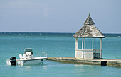 7 to 12 months, 7-12 months, Blue, Boat, Boats, Calm, Calmness, Caribbean, Color, Colour, Contemporary, Daytime, Deserted, Dock, Docks, Exterior, Gazebo, Greater Antilles, Holiday, Holidays, Horizontal, Hut, Island, Islands, Jamaica, Motorboat, Motorboat