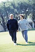 Mature couple walking outdoors in sportswear, Florida