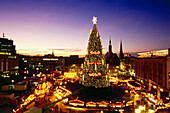 View over Christmas market with giant Christmas tree in the evening, Dortmund,  North Rhine-Westphalia, Germany