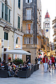 People sitting in cafes in the city in the evening, Corfu, Ionian Islands, Greece