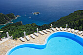 View of the pool of Golden Fox Hotel, coastal landscape in the background, Corfu, Ionian Islands, Greece