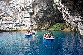 Cephalonia, tourists driving in boats in front of Melissani cave in Sami, Ionian Islands, Greece