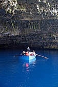 Cephalonia, tourists driving in a boat in front of Melissani cave in Sami, Ionian Islands, Greece