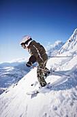 Boy (6 years) skiing, Valfagehr downhill, Sankt Anton am Arlberg, Tyrol, Austria