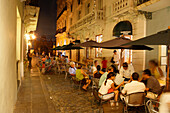 People sitting in front of a cafe at the Old Town in the evening, Calle de Christo, San Juan, Puerto Rico, Carribean, America