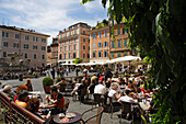 People sitting in a sidewalk cafe at Piazza Sta Maria, Trastevere, Rome, Italy, Europe