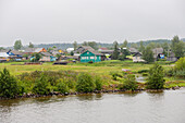 Residential buildings on Sheksna river in Goritsy, Oblast Vologda, Russia