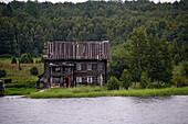 Damaged wooden house, Lake Onega, the second biggest lake in Europe, Russia