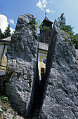 split rock with chapell, Klobenstein, canyon of Entenlochklamm, Tiroler Ache, Tiroler Achen, Chiemgau range, Tyrol, Austria