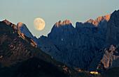 moonrise above Wilder Kaiser range with alpine hut Stripsenjochhaus, Wilder Kaiser range, Kaiser Mountain Range, Tyrol, Austria
