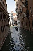 Gondola on a canal, Venice, Veneto, Italy