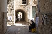 Woman selling Lace in an alley, Dubrovnik, Dubrovnik-Neretva, Croatia