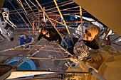 Couple climbing up the mast of the Royal Clipper, Mastclimbing, Aboard Sailing Cruiseship Royal Clipper (Star Clippers Cruises), Adriatic Sea, near Kotor, Montenegro