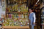 Saleswoman outside a Limoncello Shop, Capri, Campania, Italy