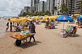 Fresh fruit vendor with cart selling fruit on the beach, Recife, Pernambuco, Brazil, South America