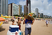 Fruit drink vendor with hat selling fruit juice on the beach, Recife, Pernambuco, Brazil, South America