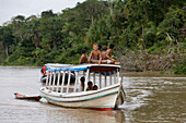 Young Amazon Indian boys on a boat on the Rio do Cajari, a branch of the Amazon River, Para, Brazil, South America