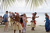 Passengers from the Cruiseship Star Flyer (Star Clippers Cruises) dancing with locals at a beach barbecue party, Fakarava, The Tuamotus, French Polynesia