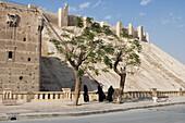 Veiled women outside the Citadel of Aleppo, Aleppo, Syria, Asia