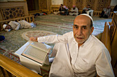 Muslim man reading from the Koran in Aleppo Great Mosque, Aleppo, Syria, Asia