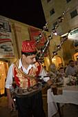 Man pouring Arabian Coffee during Ramadan Iftar Buffet at Sheraton Aleppo Hotel, Aleppo, Syria, Asia