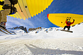 Snowboarder and skier using Woop-Jump, Grimentz, Valais, Switzerland