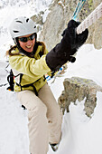 Female skier climbing on a rope to slope, Val Strem, Disentis, Val Strem, Grisons, Switzerland