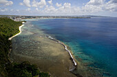 High angle view at Tumon bay with Gun Beach under clouded sky, Guam, Micronesia, Oceania