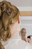 Bride looking at mirror, Palatinat, Germany