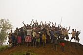 A group of cheering children, Langila, Papua New Guinea, Oceania