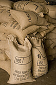 Bags filled with coffee beans, Coffee plantation, Langila, Highlands, Papua New Guinea, Oceania