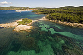 Aerial view of a bay on Porquerolles with city, Iles d'Hyeres, France, Europe