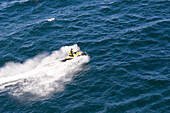 Aerial view of a person on a jet ski, Iles d'Hyeres, France, Europe