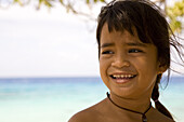 Smiling girl at Tuamotu Islands, French Polynesia, Polynesia, Oceania