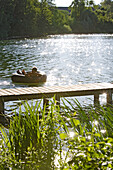 Boy bathing at Wesslinger Lake on a summer's day, Bavaria, Germany