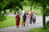People walking meditative at the buddhist festival, Westpark, Munich, Bavaria, Germany