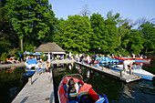 People driving boats, boat rental at Kleinhesseloher See, English Garden, Schwabing, Munich, Bavaria, Germany