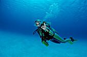 Scuba diver shows o.K. signal, Netherlands Antilles, Bonaire, Caribbean Sea