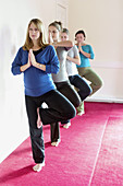 Four pregnant ladies in a pre natal yoga class