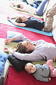 Mothers in post natal yoga class with their babies