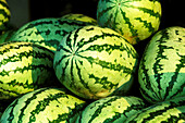 Abundance, Abundant, Agriculture, Aliment, Aliments, Close up, Close-up, Closeup, Color, Colour, Country, Countryside, Economy, Farming, Food, Green, Heaped, Horizontal, Many, Market, Markets, Melon, Melons, Piled up, Produce, Product, Products, Rural, S