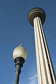 TEXAS San Antonio. Tower of the Americas, Hemisfair Park, street lamp, optical illusion, size contrast