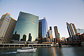 Illinois. Chicago. Chicago River in downtown loop area of city, 333 West Wacker Drive building on curve of river, landmark structure, power boat on water