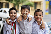 Portrait of three boys after school. The Old Quarter, Hanoi, Vietnam, Indochina, Southeast Asia, Asia 2006