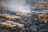 Food stalls and activity at sunset in DJemma El-Fna. Marrakech. Morocco.