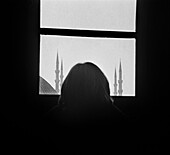 Adult, Adults, Anonymous, Asia, B&W, Back view, Back-light, Backlight, Black-and-White, Building, Buildings, Cities, City, Daytime, Europe, Female, Half-light, Horizontal, Human, Indoor, Indoors, Inside, Interior, Istanbul, Minaret, Minarets, Mosque, Mos