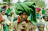 Adult, Adults, Africa, Black people, Color, Colour, Daytime, Ethiopia, Ethnic, Ethnicity, Exterior, Folk, Folklore, Gesture, Gestures, Gesturing, Headgear, Horizontal, Human, Looking at camera, Male, Man, Men, Outdoor, Outdoors, Outside, People, Person,