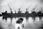Adult, Adults, Alone, B&W, Black-and-White, Calm, Calmness, Caucasian, Caucasians, Contemporary, Crane, Cranes, Daytime, Dock, Docks, Exterior, Female, Harbor, Harbors, Harbour, Harbours, Horizontal, Human, Light, Lighting, One, One person, Outdoor, Outd